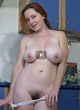 Freckled redhead with big tits fingering her hairy pussy