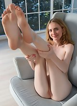 Sexy blonde Lena Flora nude in a chair