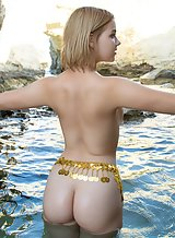 Cute blonde with a big butt nude in the sea