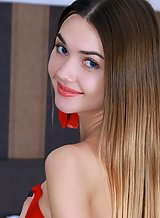 Shaved teen with blue eyes pulls her panties aside
