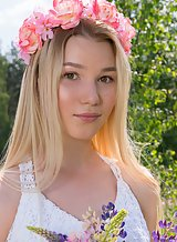 Adorable blonde teen nude in a field