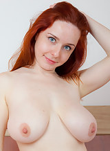 Chubby freckled redhead shows off her big tits